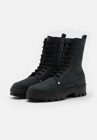 DECHASE - BOKINA UNISEX - Lace-up ankle boots - black - 1