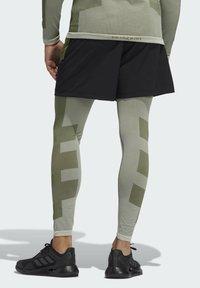 adidas Performance - STUDIO TECH SHORTS - Sports shorts - green - 2