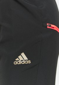 adidas Performance - ADAPT  - Tracksuit bottoms - black - 4