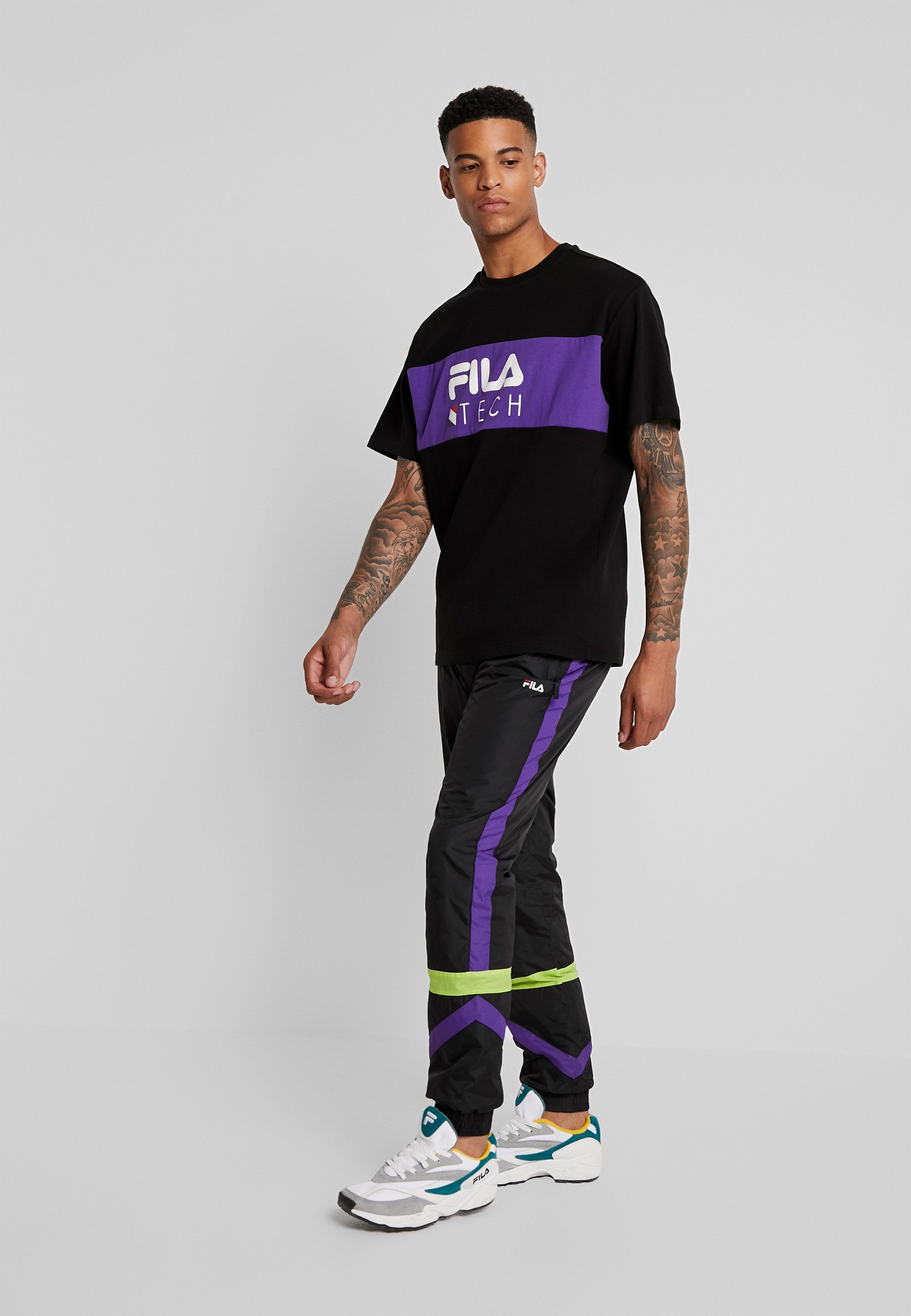 Fila REIGN TRACK PANTS - Joggebukse - black/tillandsia purple/acid lime