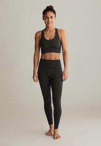 OYSHO - WITH CROSSOVER BACK - Sports bra - dark grey - 1