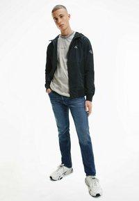 Calvin Klein Jeans - Kevyt takki - ck black - 1