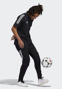 adidas Performance - TIERRO GOALKEEPER TRACKSUIT BOTTOMS - Verryttelyhousut - black - 1