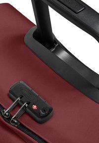 Eastpak - TRANVERZ M - Wheeled suitcase - brisk burgundy - 3