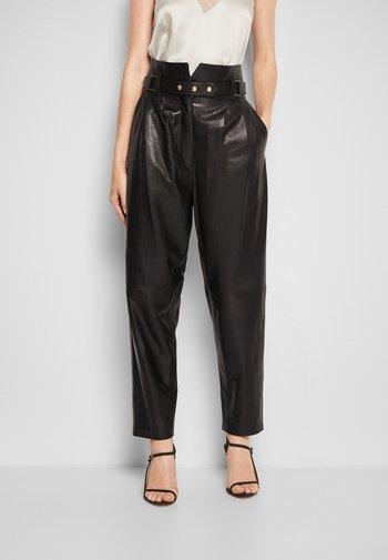KIN - Leather trousers - black