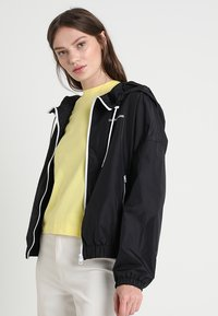 Calvin Klein Jeans - Summer jacket - black - 0
