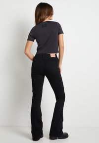 Pepe Jeans - DUA LIPA X PEPE JEANS - Flared Jeans - black - 2