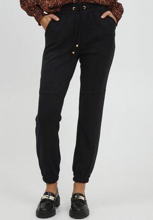 BYPUSTI - Teplákové kalhoty - black