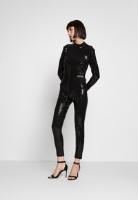 Jaded London - LONG SLEEVE LUREX CATSUIT WITH THONG BACK DETAIL - Jumpsuit - black - 1