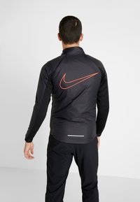 Nike Performance - TRACK AIR - Chaqueta de deporte - black/scream green/bright crimson - 2