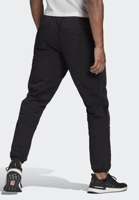 adidas Performance - ADIDAS Z.N.E. PADDED TRACKSUIT BOTTOMS - Tracksuit bottoms - black - 1