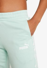 Puma - AMPLIFIED PANTS  - Pantalones deportivos - mist green - 5