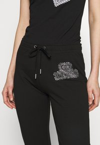 Love Moschino - Verryttelyhousut - black - 5