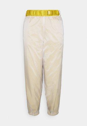 PANT - Tracksuit bottoms - dark citron/white/black