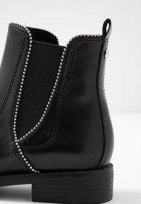 s.Oliver - Kotníkové boty - black - 2