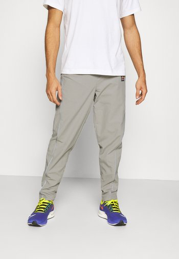 RIGARIO TRACK PANT - Pantaloni sportivi - light grey