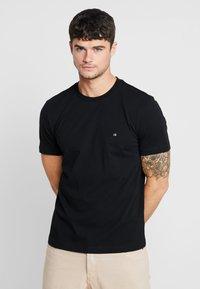 Calvin Klein - Jednoduché triko - black - 0