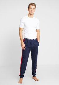 Tommy Hilfiger - PANEL PANT - Pyjama bottoms - blue - 1