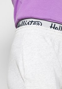 Hollister Co. - LOGO - Tracksuit bottoms - light grey - 4