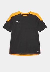 Puma - FTBLNXT UNISEX - Print T-shirt - black/shocking orange - 0