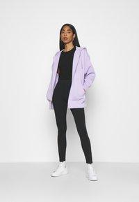 Nike Sportswear - LEGASEE  - Leggings - Trousers - black - 1