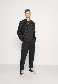 Armani Exchange - JACKET - Summer jacket - black - 1