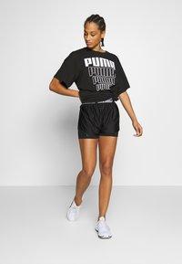 Puma - REBEL LIGHT WEIGHT TEE DRESS - Vestido de deporte - black - 1