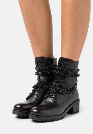 PRIMROSE - Cowboy/biker ankle boot - black
