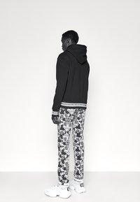 Versace Jeans Couture - TUPO - Slim fit jeans - black - 4