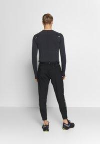 Nike Performance - ELITE PANT - Teplákové kalhoty - black/reflective silver - 2