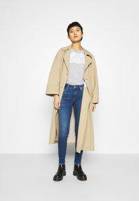 Mavi - ADRIANA - Jeans Skinny Fit - dark blue denim - 1