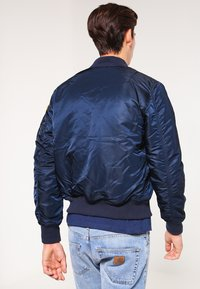 Alpha Industries - NASA - Bomber Jacket - replica blue - 2