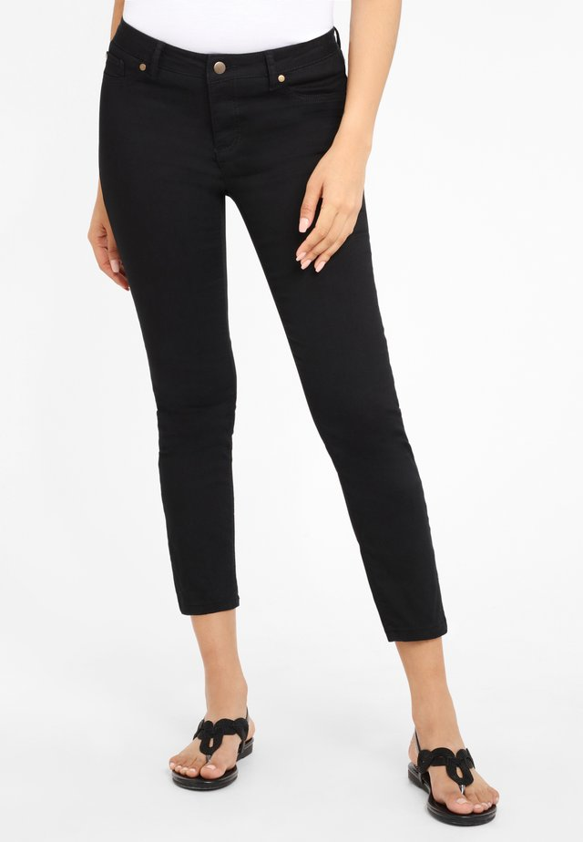 Skinny džíny - schwarz