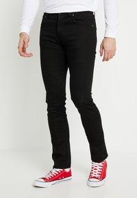 Nudie Jeans - GRIM TIM - Slim fit jeans - dry ever black - 0