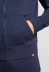 New Balance - ESSENTIALS STACKED FULL ZIP HOODIE - Zip-up hoodie - eclipse - 4