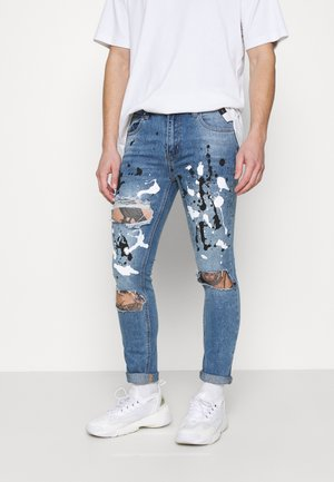 PAINT SPLATTER RIPPED - Jeansy Skinny Fit - blue