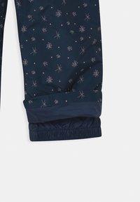 Ziener - AVATINE SLIM UNISEX - Snow pants - dark blue - 4
