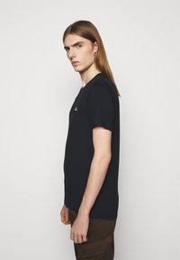 C.P. Company - SHORT SLEEVE - Basic T-shirt - black - 3