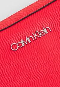 Calvin Klein - CAMERA BAG WAVE SAFFIANO - Across body bag - red - 4