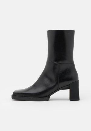 EDWINA - Kotníkové boty - black