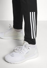 adidas Performance - AEROREADY TRAINING SPORTS PANTS - Teplákové kalhoty - black/white - 4