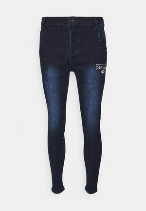 EMBOSSED PRINT - Jeans Skinny Fit - raw blue