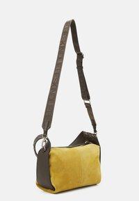 Liebeskind Berlin - HOBO S - Handbag - dijon - 1