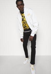 Versace Jeans Couture - AMETIST  - Slim fit jeans - black - 3