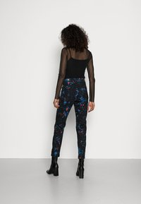 Desigual - PANT SPLATTER - Slim fit jeans - black - 2
