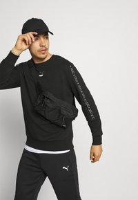 Puma - ELEVATE CREW  - Sweatshirt - black - 3