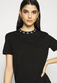 Calvin Klein Jeans - LOGO TRIM DRESS - Vestito di maglina - black - 3