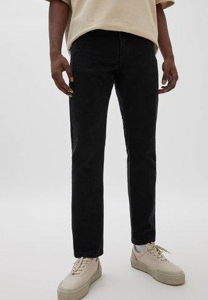 Straight leg jeans - mottled black