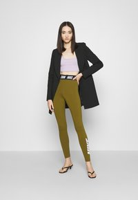Nike Sportswear - CLUB  - Leggings - olive flak/white - 1