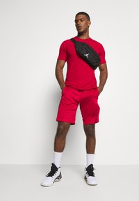 Jordan - AIR DRY SHORT - Sports shorts - gym red/black/black - 1
